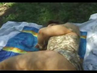 dark brown wife is taking a nap outdoors acquires