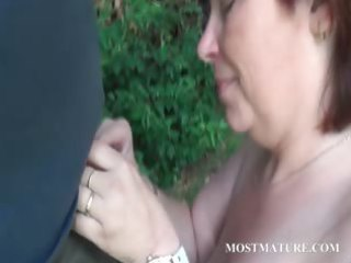 stripped mommy blows hard pecker outdoor